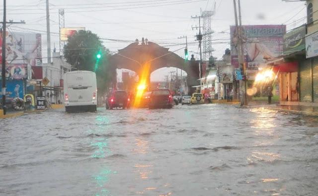 Inundación, coladeras, lluvias