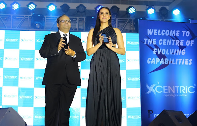 Priyanka Communications MD, Manish Agarwal with Bollywood actor Neha Dhupia at the CENTRiC Smartphone launch (1)