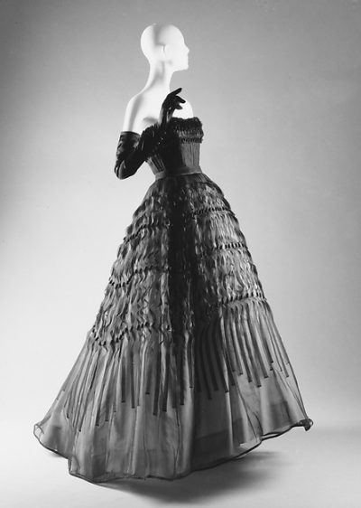 "Beautiful black long evening gown displayed on mannequin from Dior's 1951 ""Diorama"" Collection"