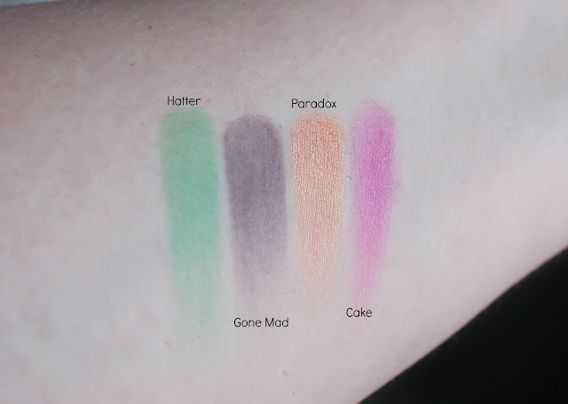 Photo of swatches of The Mad Hatter Shades from the Urban Decay Alice Through the Looking Glass Palette