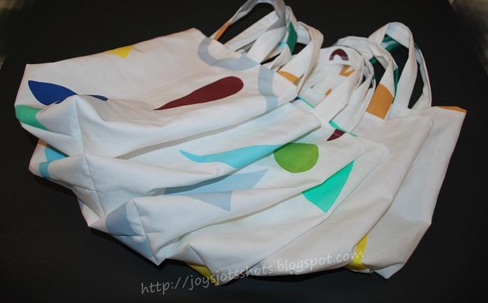 http://joysjotsshots.blogspot.com/2013/05/mass-producing-gift-bags.html