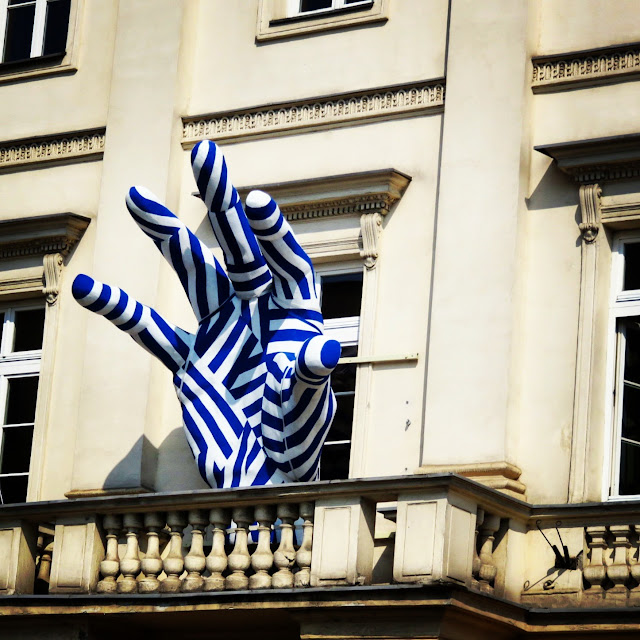Giant striped blue hand sculpture in Warsaw, Poland