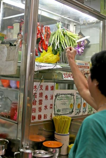 The smashed glass display at the front of the wonton mee stall.
