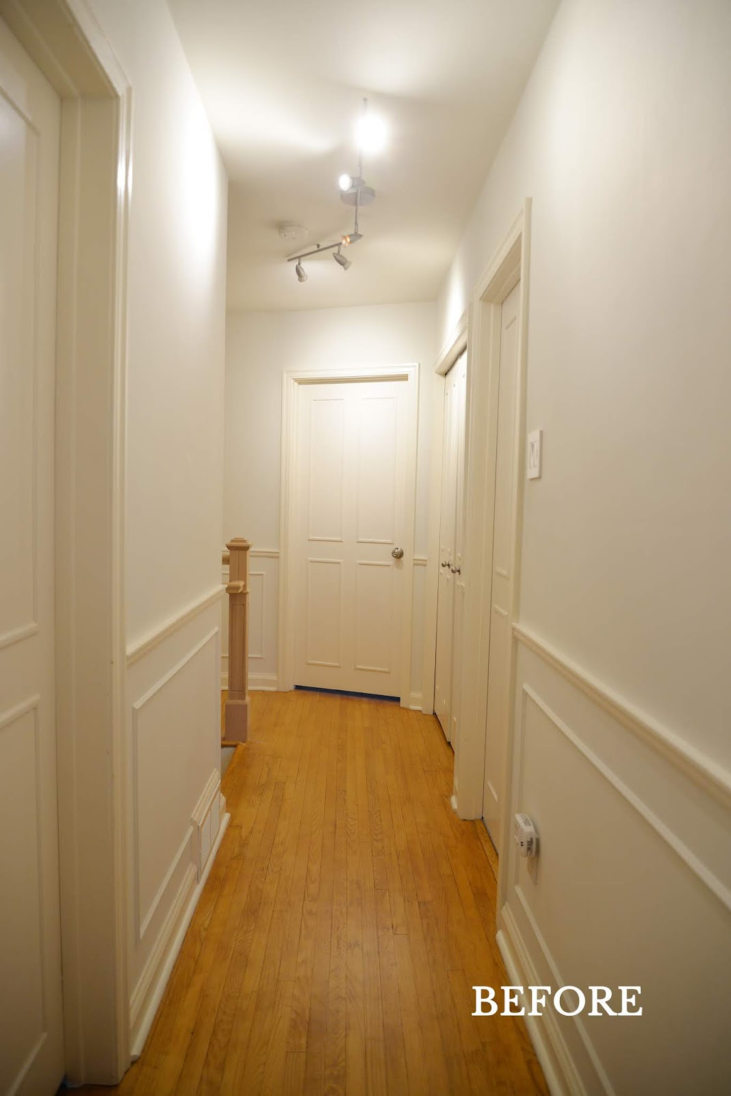 hallway with cream trim and moulding