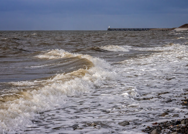 Photo of waves sweeping onto the shore at Maryport