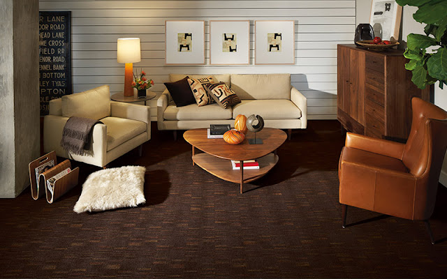 Patterned carpets allow you to go dark without making a room feel too heavy.