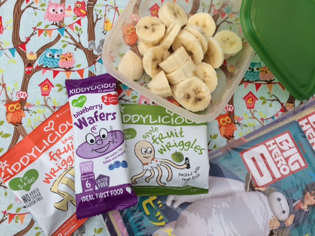 Kiddylicious snacks with fresh fruit and a colouring book