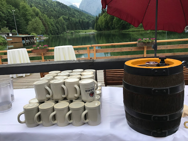 tapping a barrel of beer,  shades of raspberry and apricot, lake-side wedding in the Bavarian mountains, Garmisch-Partenkirchen, Germany, wedding venue Riessersee Hotel, wedding planner Uschi Glas, getting married abroad