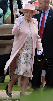 The Queen wore a pink floral dress with matching coat and hat for Charlotte's Christening