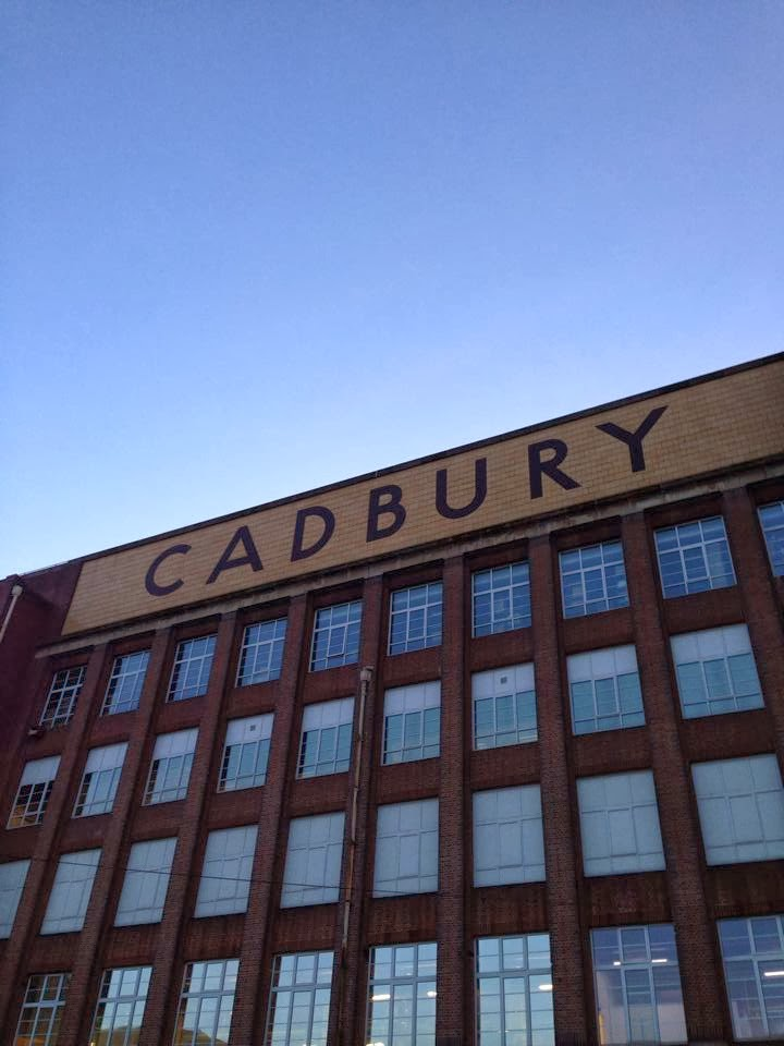 The exterior of the original Cadbury factory with the family name written on the side