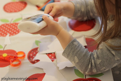 gluing together the bird paper toy