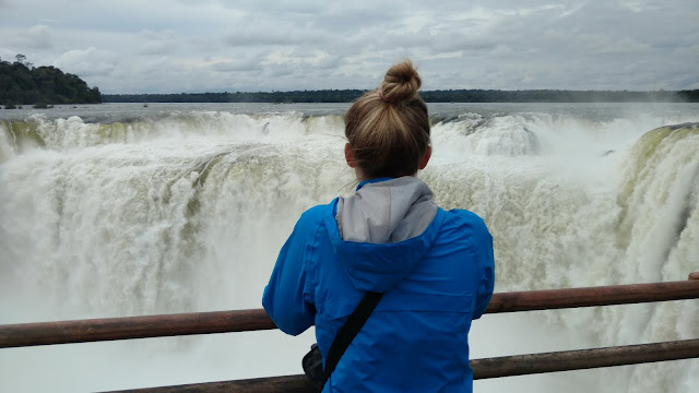 a girl gazes at Devil's Throat, Iguazu
