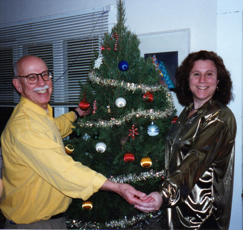 Albert Marsh and Leslie Harris around the Christmas tree