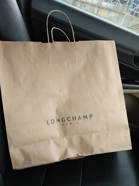 image of Longchamp paper bag