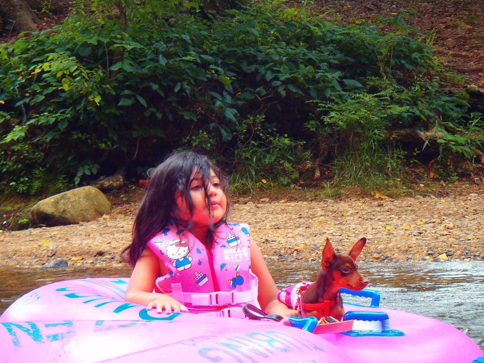 Girl tubing with dog in Helen Georgia