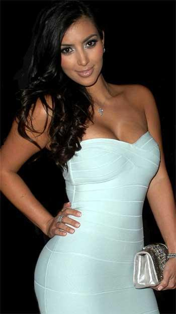Kim Kardashian wearing white Herve Leger bandeau dress