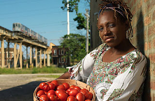 LaDonna Redmond holding a basket of red tomatoes