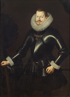 Portrait of the 17th century King Philip III of Spain and Portugal. He is wearing a  black suit with large white frills at the neck and wrist.