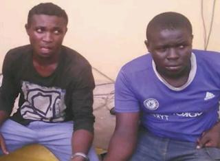 Two black thieves handcuffed to each other
