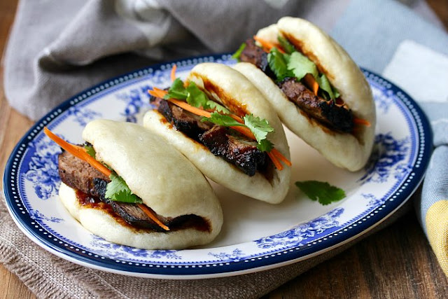 Bao Buns with picked vegetables and filled with char sui