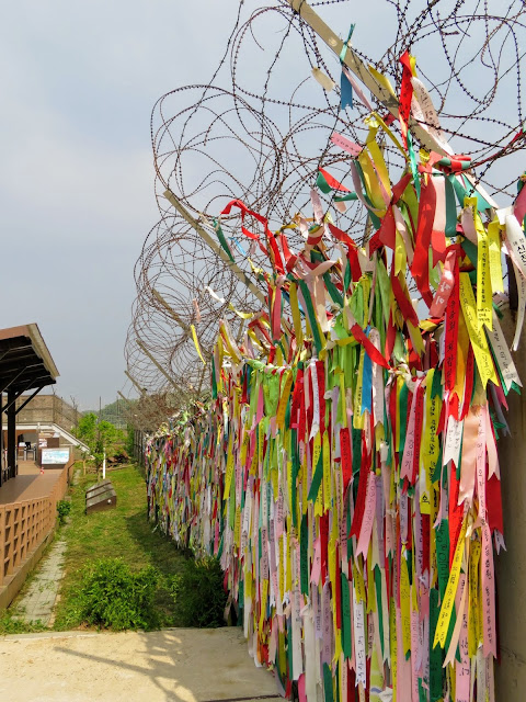 Barbed wire and ribbons with messages of hope in the DMZ in South Korea