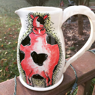 http://www.karenolonehahn.com/product/whimsical-white-ceramic-pitcher-hand-painted-cow-ceramic-stoneware-handmade-ceramic-pitcher-