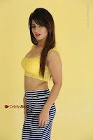 Cute Telugu Actress Shunaya Solanki High Definition Spicy Pos in Yellow Top and Skirt  0100.JPG