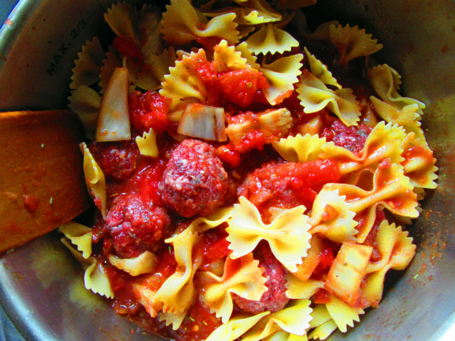 Pressure-cooker mini meatballs with farfalle by Laka kuharica: stir in and submerge pasta and meatballs in the sauce.