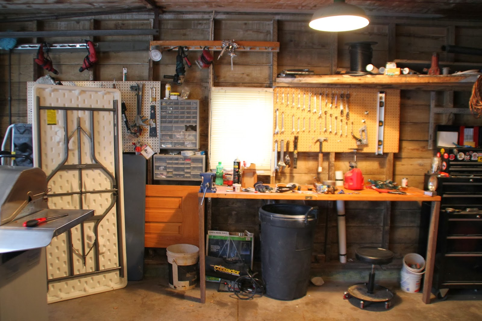 And This Is What His Garage Looks Like Now After The Installation To Install Wood Stove