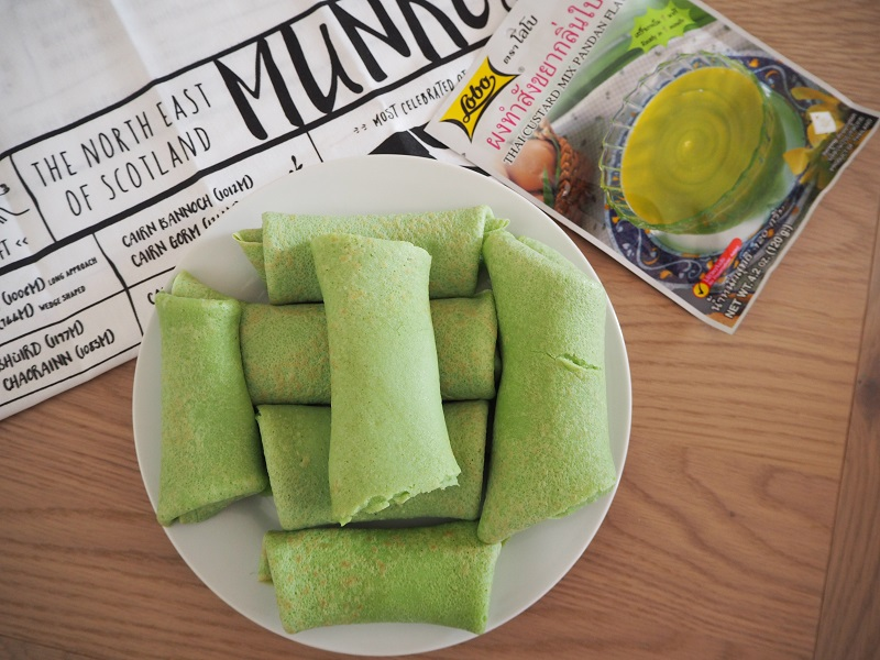 Pandan pancake rolls stacked on a plate