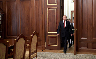 Vladimir Putin and young citizens of Russia visiting President's office.