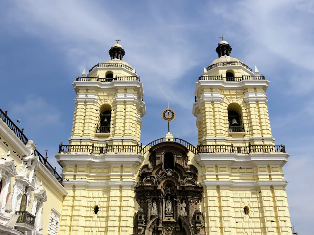 Colonial-style yellow church in central Lima.