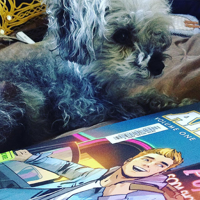 Murchie lies alongside a trade paperback copy of Archie Volume One. Its cover features a redhaired white boy climbing out of a car, a huge grin on his face.
