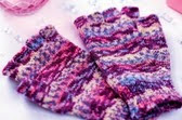 http://www.letsknit.co.uk/free-knitting-patterns/lucinda_gandertons_self-patterning_fingerless_gloves