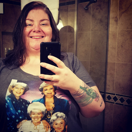 image of me with wet hair from mid-torso up, wearing a Golden Girls t-shirt, taking a picture of myself in a mirror