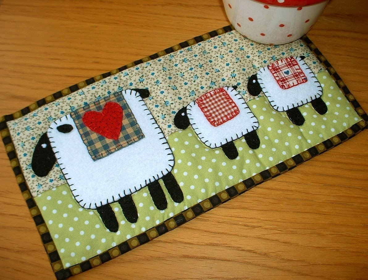 http://www.craftsy.com/pattern/quilting/home-decor/spring-lambs-mug-rug/44391