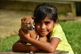 Image: Little girl hugging puppy, by LATUPEIRISSA on Pixabay