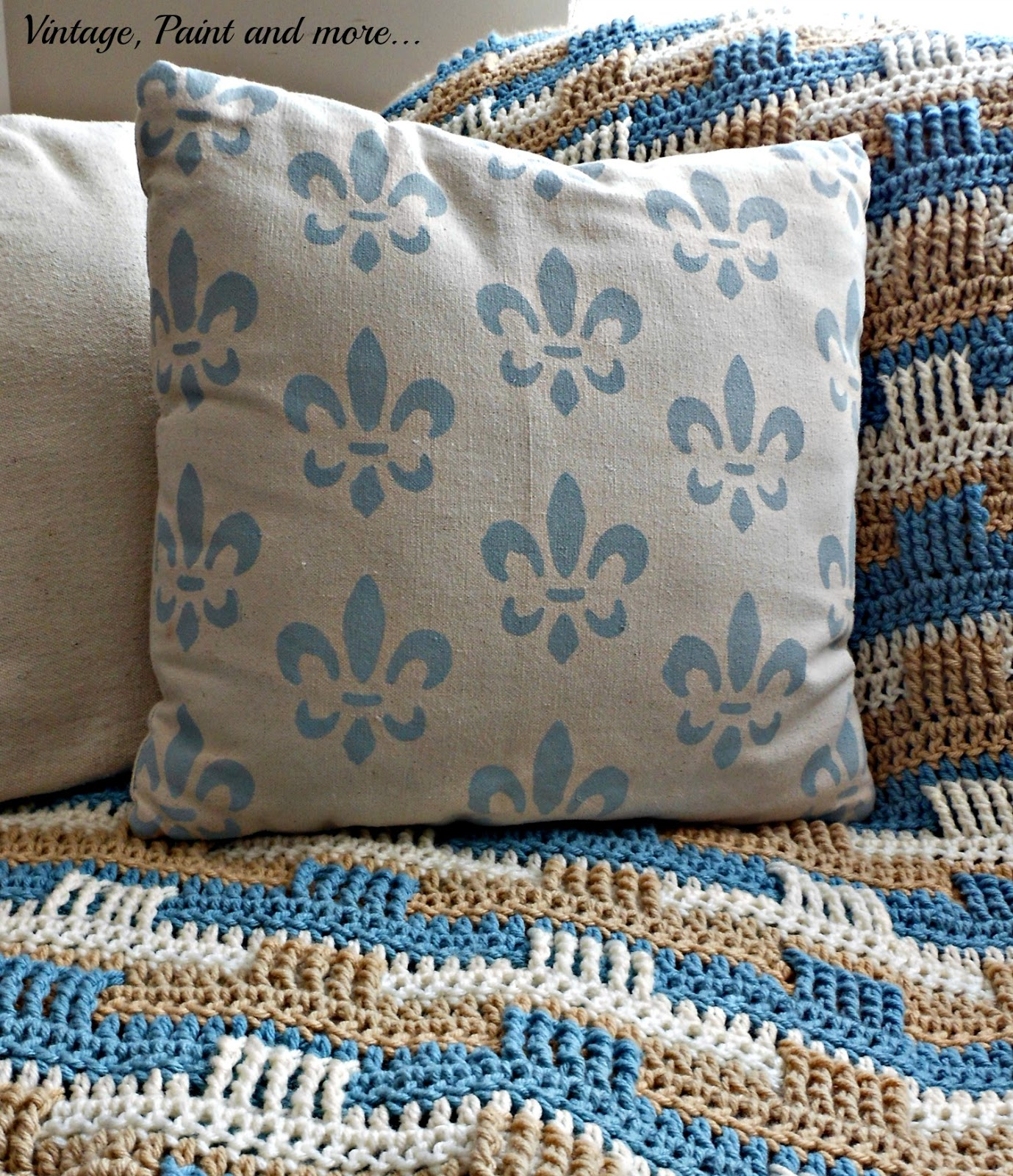 a pillow made from drop cloth fabric and stenciled in a fleur de lis design with craft paint