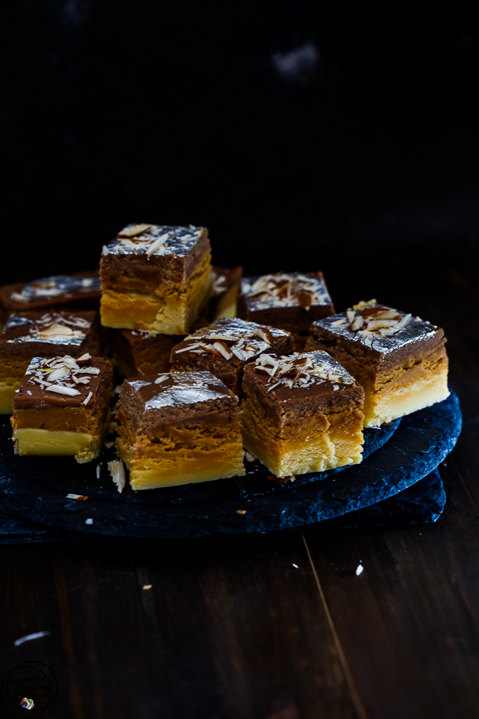Barfi is a popular Indian sweet and can be made easily at home. Three decadent layers of barfi with a western twist, a symphony of vanilla, caramel and chocolate flavours. Preciously rich and milky, perfect anytime.