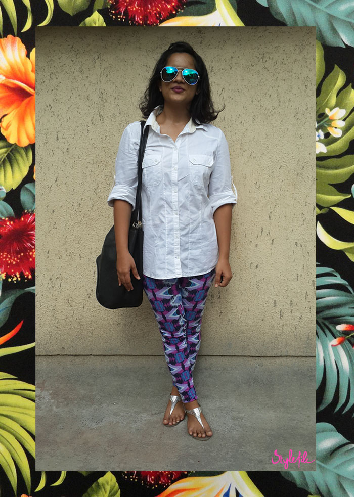 Dayle Pereira, the fashion blogger at Style File showcases her personal style with a Zara shirt, Reliance Trends printed leggings, leather bucket bag, reflective sunglasses and silver sandles