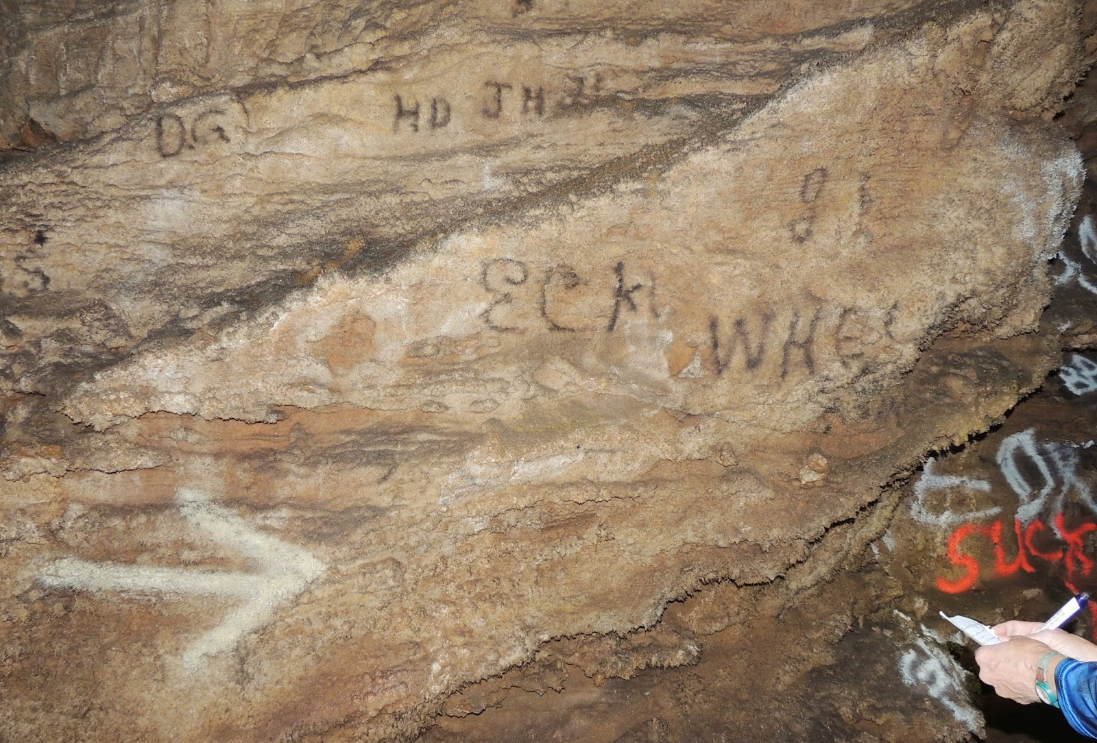 heat in the form of carbide lamps and evidently had no compunction against sooting their names and dates on the cave s walls photo by steve bailey