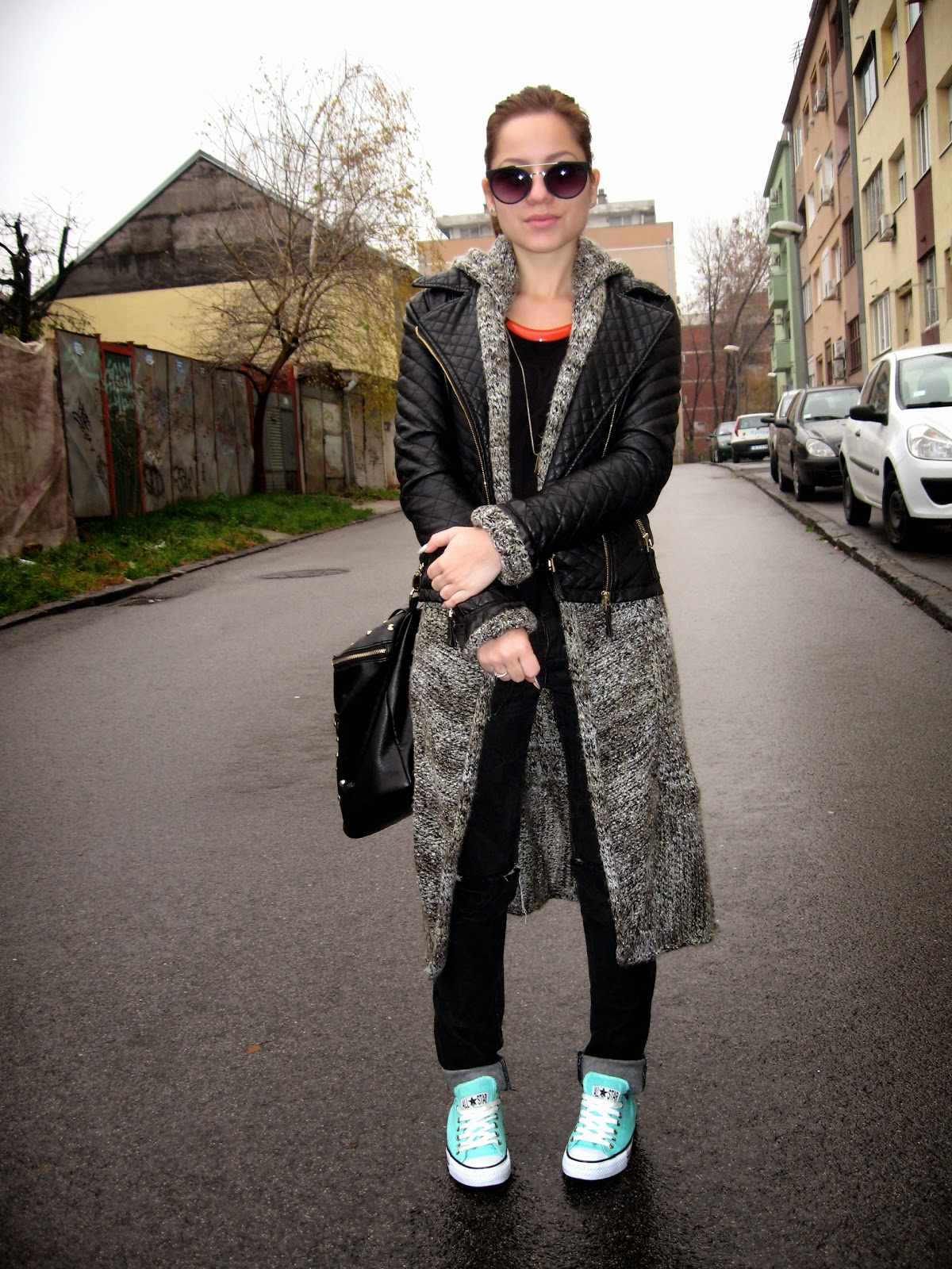 outfit, mint converse sneakers, sweater jacket, long cardigan, black faux leather jacket, orange necklace, knee ripped black jeans