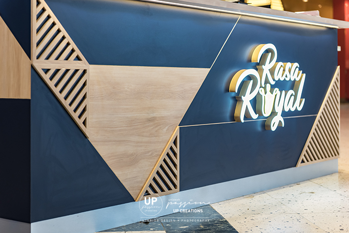 Sunway pyramid rasa royal kiosk with royal blue color laminate finish and triangle wood strips