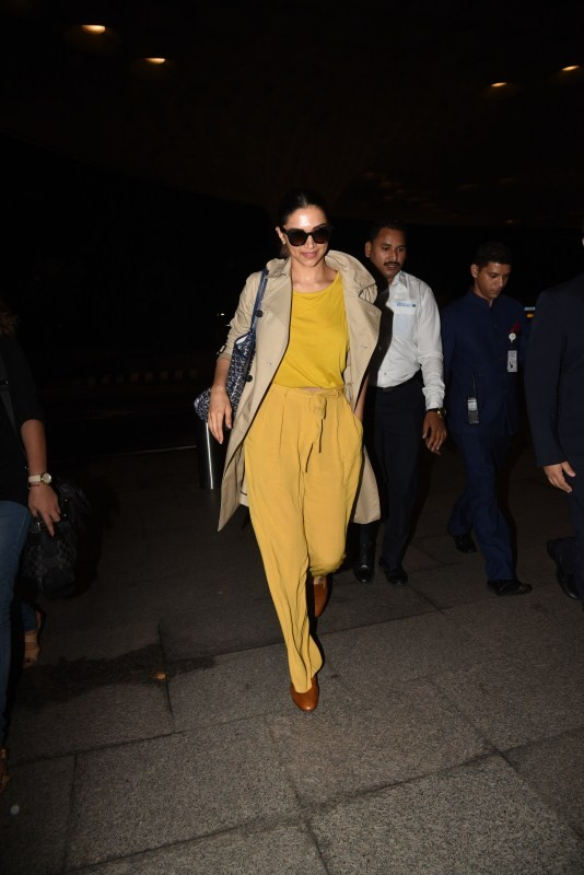 Deepika Padukone Spotted In Bright Yellow Dress at Airport