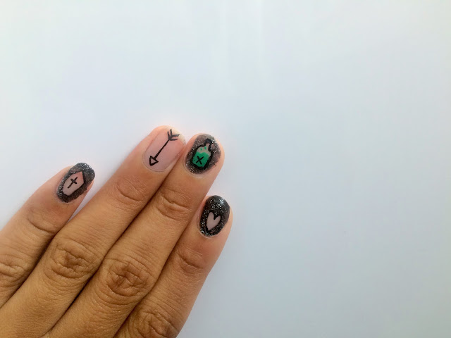 Finger nail art inspired by The Addams Family musical