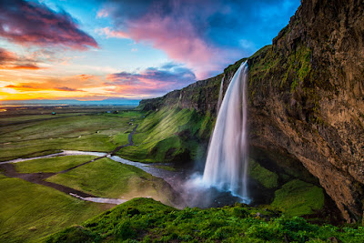 Seljalandsfoss, pictured at sunset, is considered Iceland's most beautiful waterfall