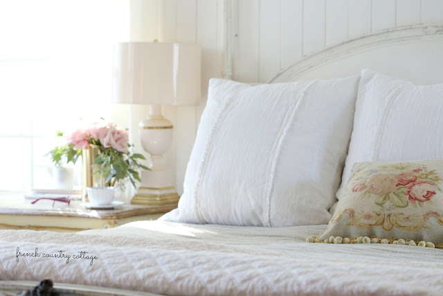 Simple & beautiful long ruffled linens in the bedroom