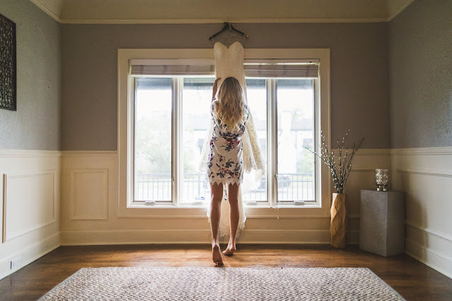 bride trying on dress