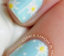 http://onceuponnails.blogspot.com/2015/04/daisies-and-dots.html