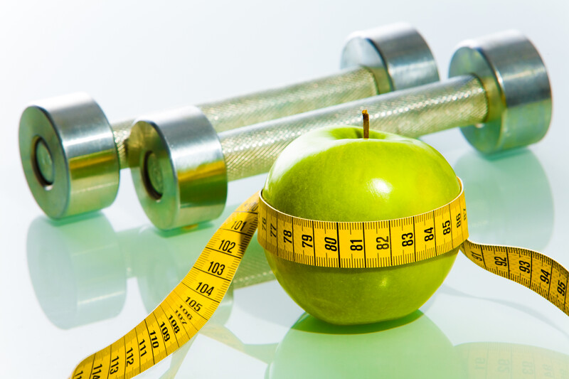 Apple with a tape measure wrapped around